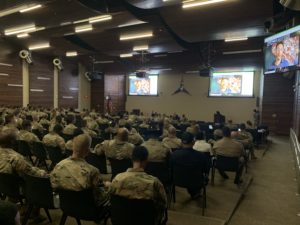 Soldiers from III Corps listen during a professional development session with Simon Sinek