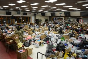 Volunteers fold, sort and organize donations